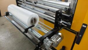 Side sealmachine Alfatechnics Servo folie-opleghaspel afwikkelaar