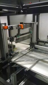 Alfatechnics. Zijlas-verpakkingsmachine-sidesealer-krimpfolieverpakkingsmachine met krimptunnel.