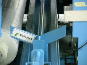 Alfatechnics Farbal-multi-breedte krimpfolieverpakkingsmachine type FM3D bovenste folierolhouders.